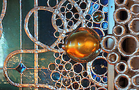 Detail of gilded glass ball and the aluminium valance made with Arsculpt and Technical Industrie, with part of a stained glass window behind, in the Bell tower room themed 'Le Merveilleux' or The Supernatural, first floor, in Le Tresor de la Cathedral d'Angouleme, in Angouleme Cathedral, or the Cathedrale Saint-Pierre d'Angouleme, Angouleme, Charente, France. The 12th century Romanesque cathedral was largely reworked by Paul Abadie in 1852-75. In 2008, Jean-Michel Othoniel was commissioned by DRAC Aquitaine - Limousin - Poitou-Charentes to display the Treasure of the Cathedral in some of its rooms, which opened to the public on 30th September 2016. Picture by Manuel Cohen. L'autorisation de reproduire cette oeuvre doit etre demandee aupres de l'ADAGP/Permission to reproduce this work of art must be obtained from DACS.