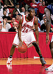Freddie Owens #24 of the Wisconsin Badgers handles the ball against the Xavier Musketeers at the Kohl Center in Madison, WI, on 12/15/2000. (Photo by David Stluka)
