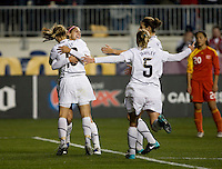 Alex Morgan (21) of the USWNT celebrates her goal with teammates Kristine Lilly (13), Lindsay Tarpley (5) and Yael Averbuch (4) during an international friendly at PPL Park in Chester, PA.  The U.S. tied China, 1-1.