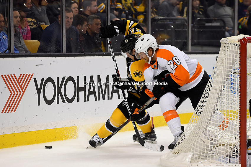 Wednesday, October 21, 2015: Philadelphia Flyers center Claude Giroux (28) and Boston Bruins defenseman Torey Krug (47) play for the puck behind the net during the National Hockey League game between the Philadelphia Flyers and the Boston Bruins, held at TD Garden, in Boston, Massachusetts. The Flyers defeat the Bruins 5-4 in overtime. Eric Canha/CSM