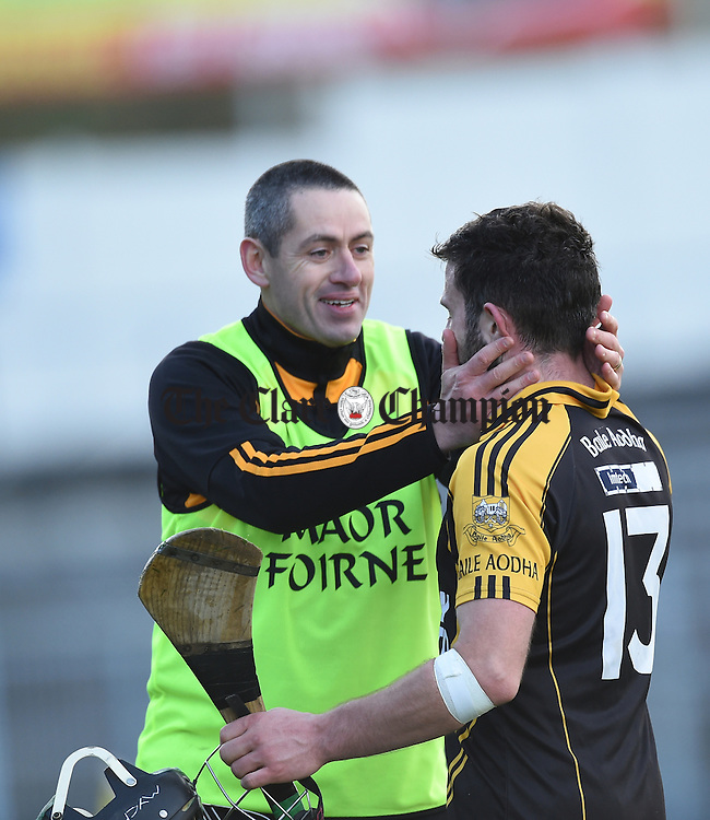 Ballyea coach Fergal Hegarty congratulates Patjoe Connolly as he is substituted during the Munster Club hurling final against Glen Rovers at Thurles. Photograph by John Kelly.