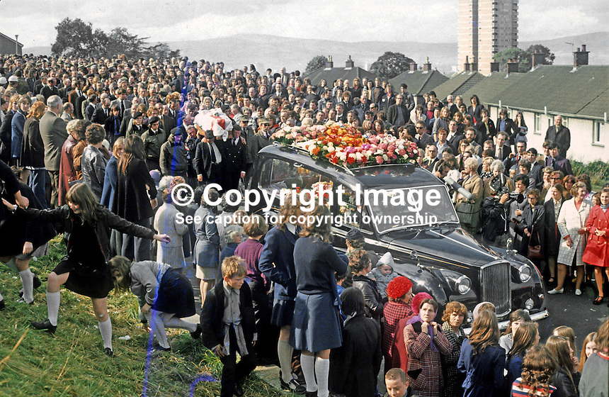 Funeral of Tommy Herron, former vice-chairman of the UDA, who was assassinated on 16th September 1973 moves off from his East Belfast home. There were four hearses to cope with the large number of floral tributes. Herron received a paramilitary funeral. The funeral service was conducted by Rev. Ian Paisley. It was attended by 25,000 mourners. He was buried at Roselawn Cemetery as a piper played Amazing Grace. 197309190590a.<br />