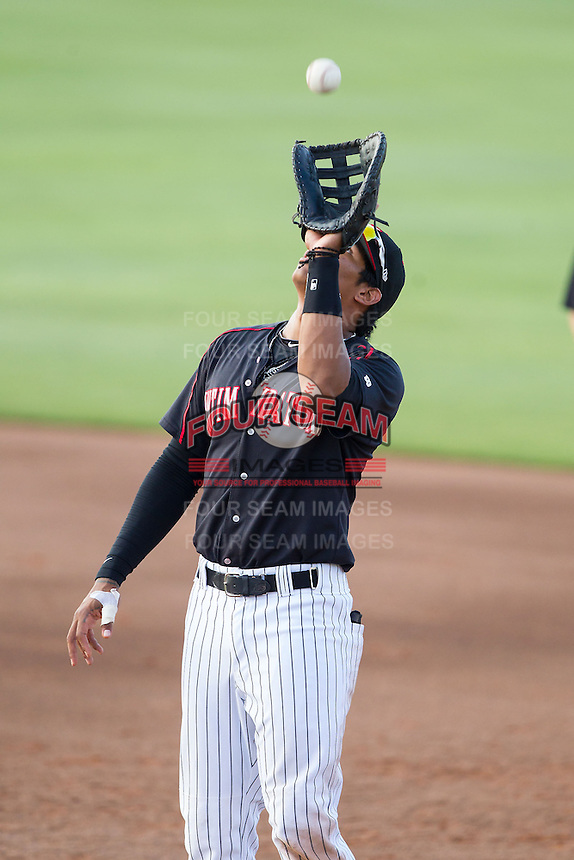 Kannapolis Intimidators first baseman Tyler Williams (6) catches a pop fly against the Hagerstown Suns at CMC-Northeast Stadium on June 1, 2014 in Kannapolis, North Carolina.  The Suns defeated the Intimidators 11-5 in game two of a double-header.  (Brian Westerholt/Four Seam Images)