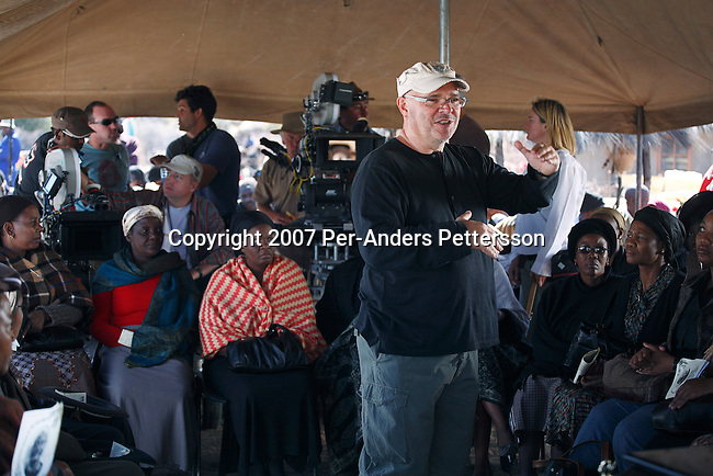 GABORONE, BOTSWANA - AUGUST 18: Anthony Minghella (l), the Oscar-winning director, instructs actors before a funeral scene on the set of The No 1 Ladies Detective Agency on August 18, 2007 in Gaborone, Botswana. The film is based on Alexander McCall Smith?s best-selling series. Mr. Minghella and his crew filmed for months around Botswana and the Government of Botswana has invested $US5 Million in the project. (Photo by Per-Anders Pettersson/Getty Images)...