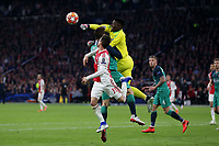 Andre Onana of Ajax punches clea under pressure from Fernando Llorente of Tottenham Hotspur during AFC Ajax vs Tottenham Hotspur, UEFA Champions League Football at the Johan Cruyff Arena on 8th May 2019