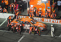 Feb 9, 2008; Daytona, FL, USA; Nascar Sprint Cup Series driver Tony Stewart (20) pits during the Bud Shootout at Daytona International Speedway. Mandatory Credit: Mark J. Rebilas-US PRESSWIRE