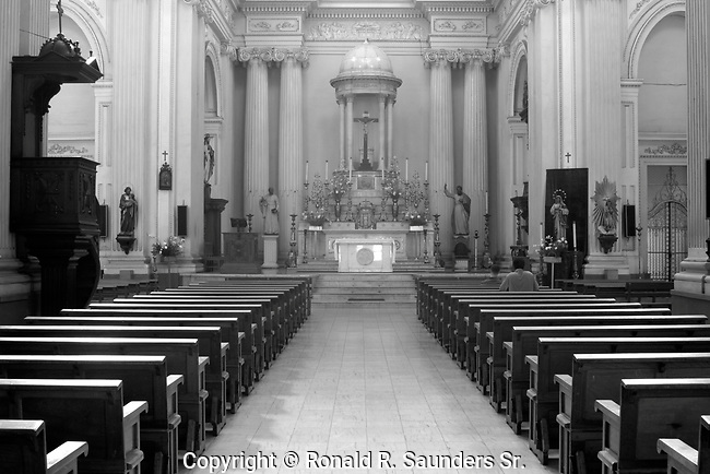 Devotee prays in Roman Catholic Church.