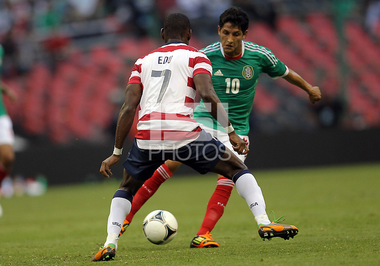 MEXICO CITY, MEXICO - AUGUST 15, 2012:  Maurice Edu (7) of the USA MNT blocks the progress of Angel Reyna (10) of  Mexico during an international friendly match at Azteca Stadium, in Mexico City, Mexico on August 15. USA won 1-0.