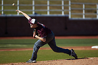Concord Mountain Lions starting pitcher Dan Nicholls (20) delivers a pitch to the plate against the Wingate Bulldogs at Ron Christopher Stadium on February 2, 2020 in Wingate, North Carolina. The Mountain Lions defeated the Bulldogs 12-11. (Brian Westerholt/Four Seam Images)