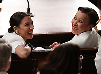 United States Representative Alexandria Ocasio-Cortez (Democrat of New York), left and United States Representative Nydia Velazquez (Democrat of New York), right, react as US President Donald J. Trump delivers his second annual State of the Union Address to a joint session of the US Congress in the US Capitol in Washington, DC on Tuesday, February 5, 2019. Photo Credit: Alex Edelman/CNP/AdMedia