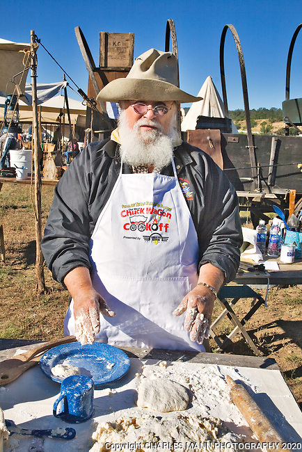 The 21st annual Lincoln County Cowboy Symposium was held in October 2010 at the Ruidoso Downs Racetrack in Ruidoso, New Mexico. Butch Littlejohn with the Camp Cookie Land & Cattle Co. out of Manchaca, Texas, makes buiscuts.