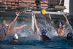 LOS ANGELES, CA - DECEMBER 03:  Alex Wolf (1) of UCLA attempts to save a shot during the Division I Men's Water Polo Championship held at the Uytengsu Aquatics Center on the University of Southern California campus on December 3, 2017 in Los Angeles, California. UCLA defeated USC 5-7 to win the National Championship. (Photo by Justin Tafoya/NCAA Photos via Getty Images)