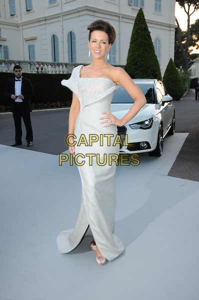 KATE BECKINSALE.arrivals at amfAR's Cinema Against AIDS 2010 benefit gala at the Hotel du Cap, Antibes, Cannes, France during the Cannes Film Festival.20th May 2010.amfAR full length long maxi dress one shoulder white silver diamante shiny sparkly sculpted hair up beige silk satin peep toe platform shoes hand on hip .CAP/CAS.©Bob Cass/Capital Pictures.