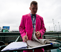 LOUISVILLE, KY - MAY 05: A fan handicaps the races on Kentucky Oaks Day at Churchill Downs on May 5, 2017 in Louisville, Kentucky. (Photo by Scott Serio/Eclipse Sportswire/Getty Images)