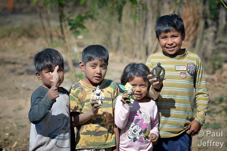 Wichi indigenous children display their toys in Embarcacion, Argentina. The Wichi in this area, largely traditional hunters and gatherers, have struggled for decades to recover land that has been systematically stolen from them by cattleraisers and large agricultural plantations.