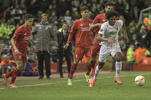 25.02.2016. Liverpool, England. UEFA Europa League game between Liverpool FC and Augsburg.  Caiuby ( FC Augsburg ) beats 3 Liverpool players