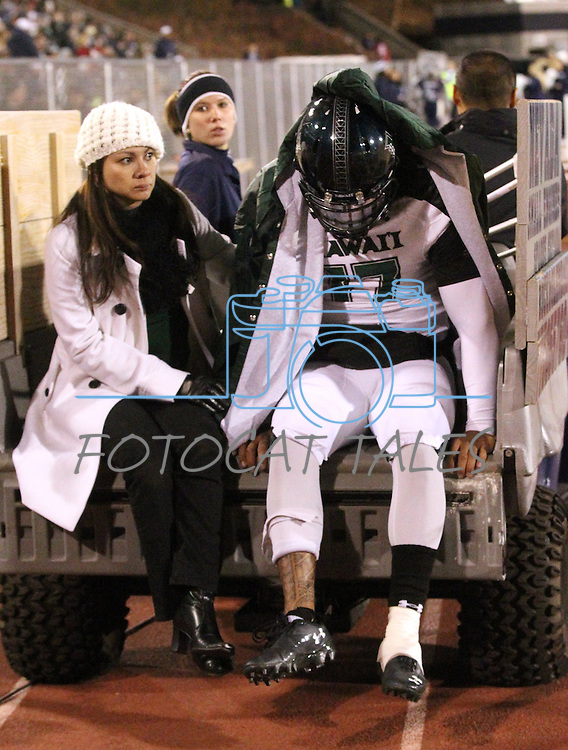 Hawaii quarterback Bryant Moniz (17) gets carted off the field after injuring his leg during the first quarter of an NCAA football game in Reno, Nev., on Saturday Nov. 12, 2011. (AP Photo/Cathleen Allison)