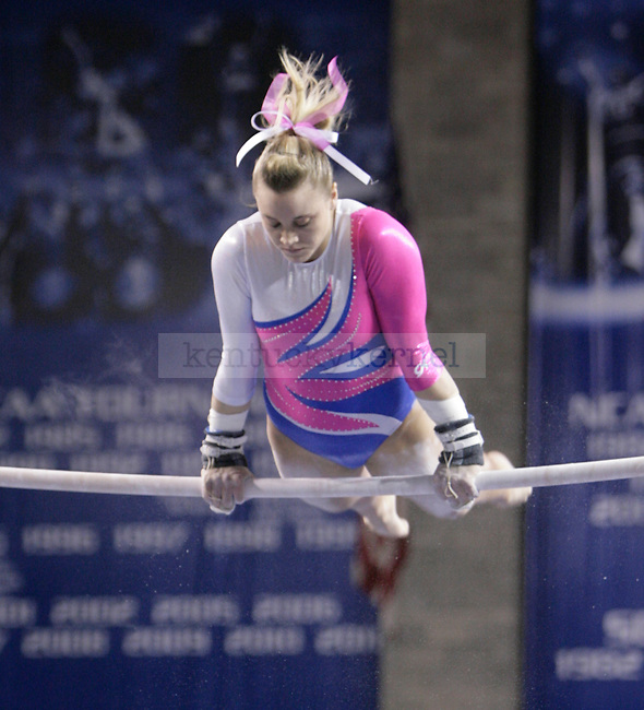 UK senior Storey performs on the uneven bars during the gymnastics meet between Kentucky, Auburn, and Pittsburgh on 2/24/12 at Memorial Coliseum in Lexington, Ky. Photo by Quianna Lige | Staff