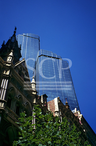 Melbourne, Australia. Ultra modern, all glass Rialto Towers office complex towers over older, stone and brick buildings.