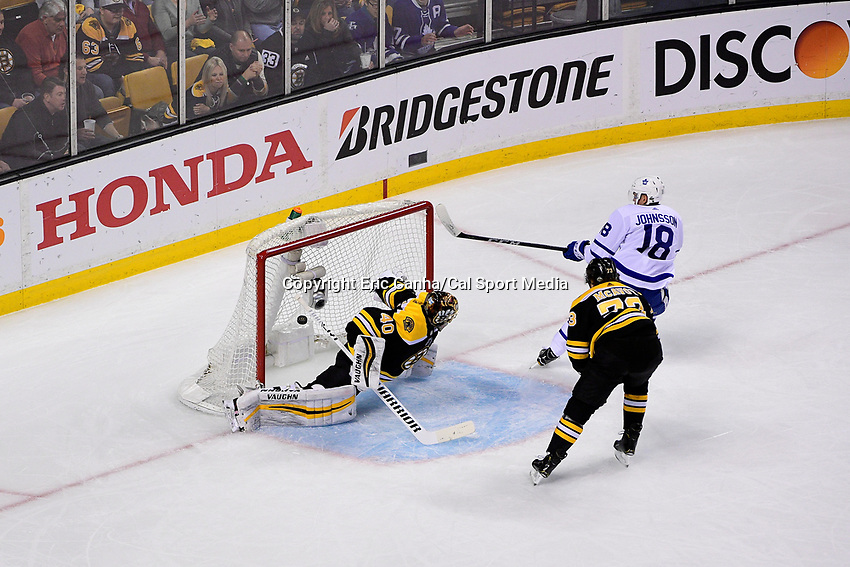 April 21, 2018: Toronto Maple Leafs left wing Andreas Johnsson (18) scores a goal on Boston Bruins goaltender Tuukka Rask (40) during game five of the first round of the National Hockey League's Eastern Conference Stanley Cup playoffs between the Toronto Maple Leafs and the Boston Bruins held at TD Garden, in Boston, Mass. Toronto defeats Boston 4-3, Boston leads Toronto 3 games to 2 in the best of 7 series.
