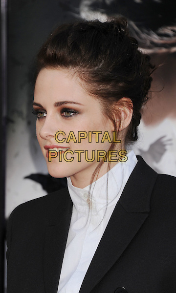 """Kristen Stewart.The Los Angeles Screening of """"Snow White And The Huntsman"""" at Westwood Village Theatre in Westwood, California, USA..May 29th, 2012 .headshot portrait black white high collar hair up smokey eyes eyeshadow make-up .CAP/ROT/TM.©Tony Michaels/Roth Stock/Capital Pictures"""