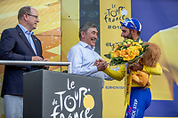 Fernando Gaviria (COL/Quick Step Floors) wins the sprint of the first stage and takes the Yellow Jersey.  Felicitated on podium by Eddy Merckx and Prince Albert of Monaco.<br /> <br /> Stage 1: Noirmoutier-en-l'&Icirc;le &gt; Fontenay-le-Comte (189km)<br /> <br /> Le Grand D&eacute;part 2018<br /> 105th Tour de France 2018<br /> &copy;kramon