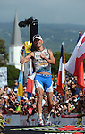 KAILUA-KONA, HI - OCTOBER 13:  Andreas Raelert of Germany crosses the finish line for a second place during the 2012 IRONMAN World Championships on October 13, 2012 in Kailua-Kona, Hawaii. (Photo by Donald Miralle)