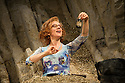 London, UK. 29.01.2014. HAPPY DAYS, by Samuel Beckett, directed by Natalie Abrahami, opens at the Young Vic. Lighting design by Paule Constable with set and cstume design by Vicki Mortimer. Picture shows: Juliet Stevenson (as Winnie). Photograph © Jane Hobson.
