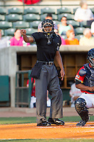 Home plate umpire Ronnie Whiting makes a strike call during the South Atlantic League game between the Greenville Drive and the Charleston RiverDogs at Joseph P. Riley, Jr. Park on May 26, 2014 in Charleston, South Carolina.  The Drive defeated the RiverDogs 11-3.  (Brian Westerholt/Four Seam Images)