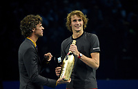 Alexander Zverev recieving a bottle of champagne by Guga Kuerten<br />  <br /> Photographer Hannah Fountain/CameraSport<br /> <br /> International Tennis - Nitto ATP World Tour Finals Day 7 - O2 Arena - London - Saturday 17th November 2018<br /> <br /> World Copyright &copy; 2018 CameraSport. All rights reserved. 43 Linden Ave. Countesthorpe. Leicester. England. LE8 5PG - Tel: +44 (0) 116 277 4147 - admin@camerasport.com - www.camerasport.com