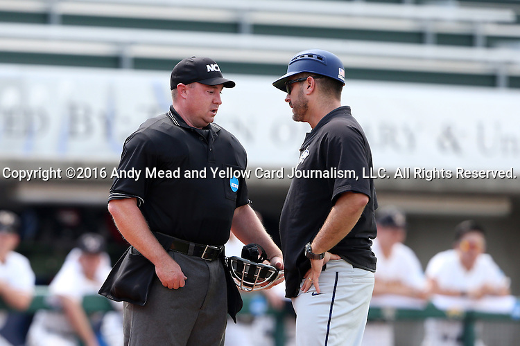 03 June 2016: Nova Southeastern head coach Greg Brown (right) and home plate umpire Brad Newton talk after Nova Southeastern's Jake Anchia (not pictured) had been hit by a pitch. The Nova Southeastern University Sharks played the Millersville University Marauders in Game 13 of the 2016 NCAA Division II College World Series  at Coleman Field at the USA Baseball National Training Complex in Cary, North Carolina. Nova Southeastern won the first game of the best of three Championship Series 2-1.