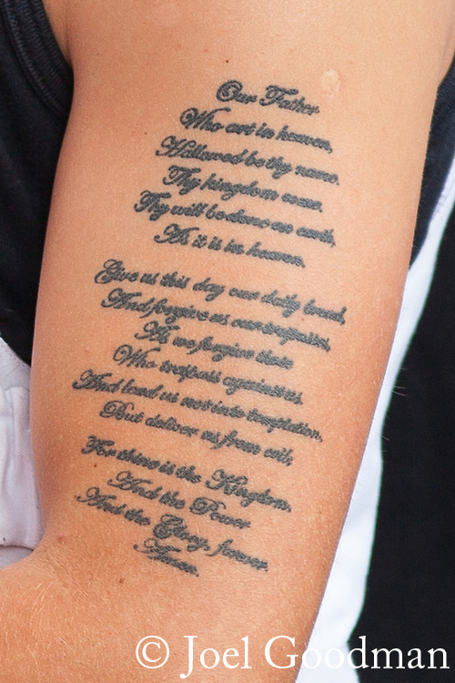 © Joel Goodman - 07973 332324 - all rights reserved . 17/07/2010 . Dudley , UK . A man with a tattoo of the Lord's Prayer on his arm , wearing a stab proof vest, at an English Defence League ( EDL ) demonstration in Dudley . Photo credit : Joel Goodman