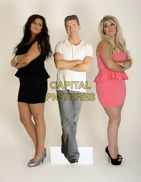 '2 Shoes' duo Lucy Texeira & Charley Bird, London, .August 30th, 2012.**Exclusive. Double fees apply.**.studio x factor full length black pink peplum dress Simon Cowell cardboard cutout arms crossed side white t-shirt silver shoes jeans denim .CAP/FIN.©Steve Finn/Capital Pictures.