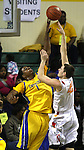 Jefferson's Terrence Jones blocks North Eugene's Joe Kammerer's shot in the 5A boys state championship at McArthur Court Friday March 13, 2009.