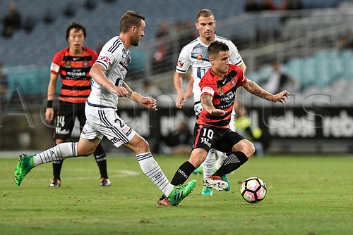 April 8th 2017, ANZ Stadium, Sydney, Australia; A-League football, Western Sydney Wanderers versus Melbourne Victory; Wanderers midfielder Nicolas Martinez tries to find a way past Victory captain Carl Valeri; The match  ended in a 0-0 draw;