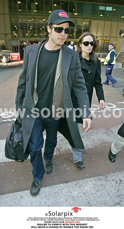 ALL-ROUND PICTURES FROM SOLARPIX.COM - 28.01.06.Brad Pitt and pregnant Angelina Jolie arriving at London Heathrow Airport today after returning from the UN meeting in Zurich..REF: RMN 2100