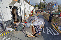 Pictured: Items destroyed by the flood, are left outside the Bridge End Inn.<br /> Re: Cleanup after storm Dennis in Crickhowell, Wales, UK.