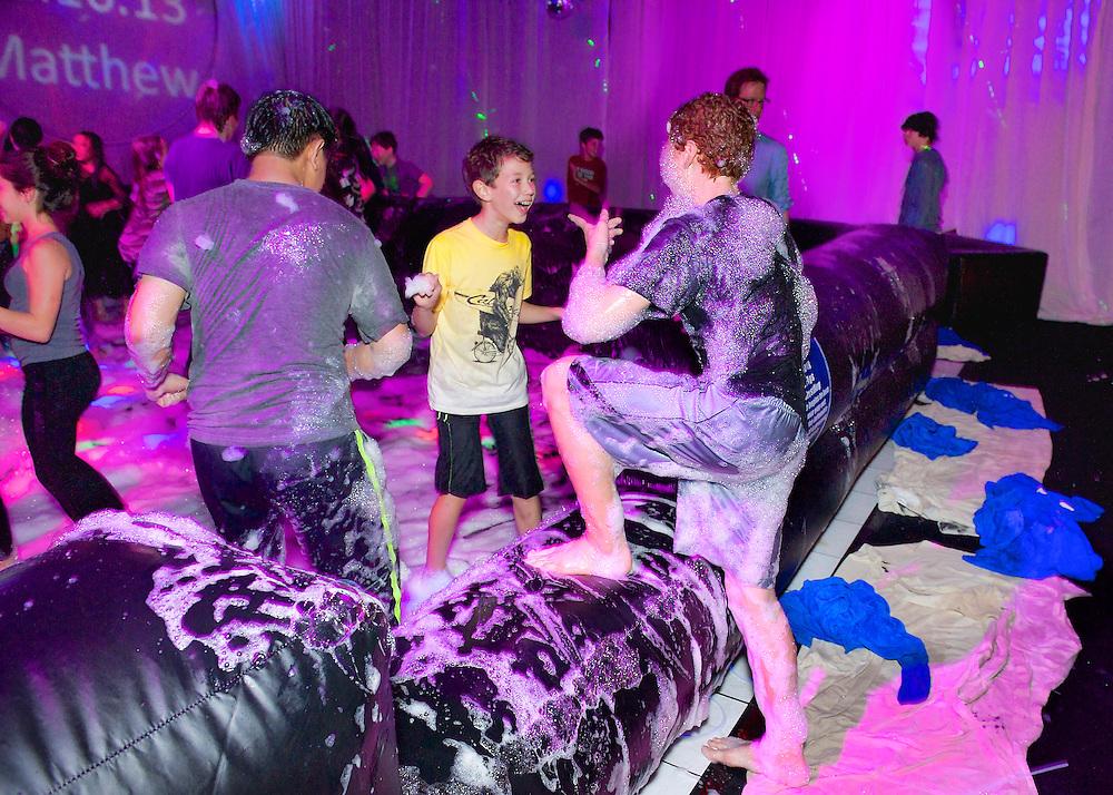 Kids covered in foam having fun.