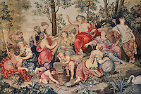 Tapestry of Apollo and the Muses on Mount Parnassus, 1687, from cartoons by Pierre Mignard, in the reception room known as the Corner Lounge, Chateau de Fontainebleau, France. The Palace of Fontainebleau is one of the largest French royal palaces and was begun in the early 16th century for Francois I. It was listed as a UNESCO World Heritage Site in 1981. Picture by Manuel Cohen