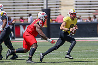 College Park, MD - April 27, 2019:  Maryland Terrapins defensive lineman Brandon Gaddy (98) chases Maryland Terrapins quarterback Max Bortenschlager (18) out of the pocket during the spring game at  Capital One Field at Maryland Stadium in College Park, MD.  (Photo by Elliott Brown/Media Images International)
