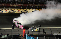 Oct. 17, 2009; Concord, NC, USA; NASCAR Sprint Cup Series driver Kyle Busch spins during the NASCAR Banking 500 at Lowes Motor Speedway. Mandatory Credit: Mark J. Rebilas-