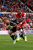 30th September 2017, Riverside Stadium, Middlesbrough, England; EFL Championship football, Middlesbrough versus Brentford; Daniel Bentley of Brentford and Britt Assombalonga of Middlesbrough collide in the 2-2 draw