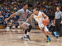 Justin Cobbs of California dribbles around Royce Woolridge of Washington State during a game at Haas Pavilion in Berkeley, California on January 5th, 2014. California defeated Washington State 76 - 55