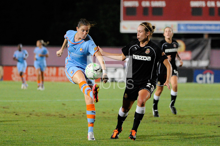 Adriana (8) of Sky Blue FC plays the ball under pressure from Whitney Engen (23) of the Western New York Flash. The Western New York Flash defeated Sky Blue FC 4-1 during a Women's Professional Soccer (WPS) match at Yurcak Field in Piscataway, NJ, on July 30, 2011.