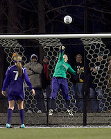 "University of Washington goalkeeper Jorde LaFontaine-Kussmann (1) flips high shot over the bar. In overtime, Boston College defeated University of Washington, 1-0, in NCAA tournament ""Elite 8"" match at Newton Soccer Field, Newton, MA, on November 27, 2010."