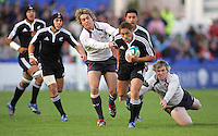 New Zealand centre Jackson Willison makes good grounf against Wales in a semi final they won 36-12.
