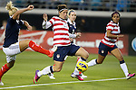09 February 2012: Abby Wambach (USA) (20), defended by Rhonda Jones (SCO) (left) and Rachael Small (SCO) (3). The United States Women's National Team defeated the Scotland Women's National Team 4-1 at EverBank Field in Jacksonville, Florida in a women's international friendly soccer match.