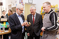 Pictured L-R: Jeremy Corbyn signs a small jar of jam with First minister for Wales Mark Drakeford and the owner of Awesome Wales, a zero waste shop in Barry. Saturday 07 December 2019<br /> Re: Labour Party leader Jeremy Corbyn pre-election campaign in Barry, south Wales, UK.
