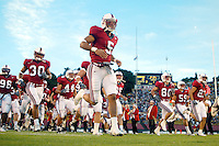 Teyo Johnson and the team during Stanford's 63-26 win over San Jose State on September 14, 2002 at Stanford Stadium.<br />