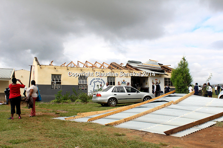 BERGVILLE - 18 March 2014 - Residents and pupils survey the damage caused to Bambazi High School in the Emmaus near Bergville following a freak storm that ripped through the area the night before and blew off the school's roof. Picture Claudine Senekal/Allied Picture Press/APP